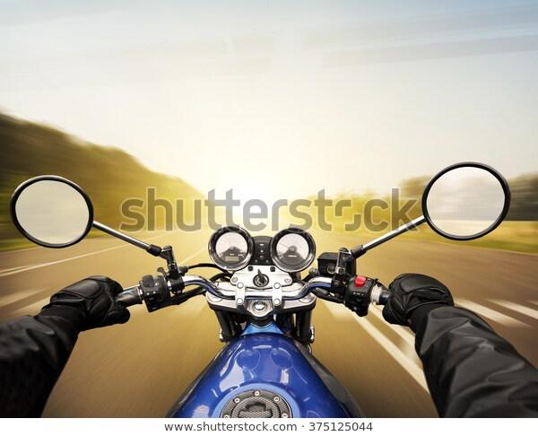 man-driving-on-moto-big-600w-375125044